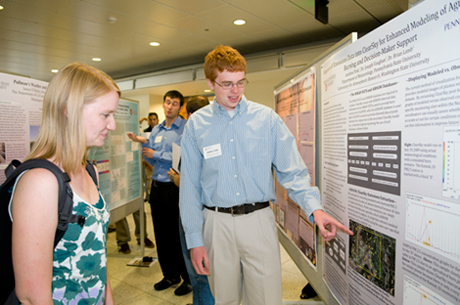 LAR REU participant Andrew Fink explains his results to Engineering 
